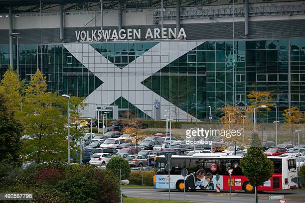 A bus passes the Volkswagen Arena home of Bundesliga soccer club VfL Wolfsburg in Wolfsburg Germany on Tuesday Oct 13 2015 Volkswagen AG Chief...