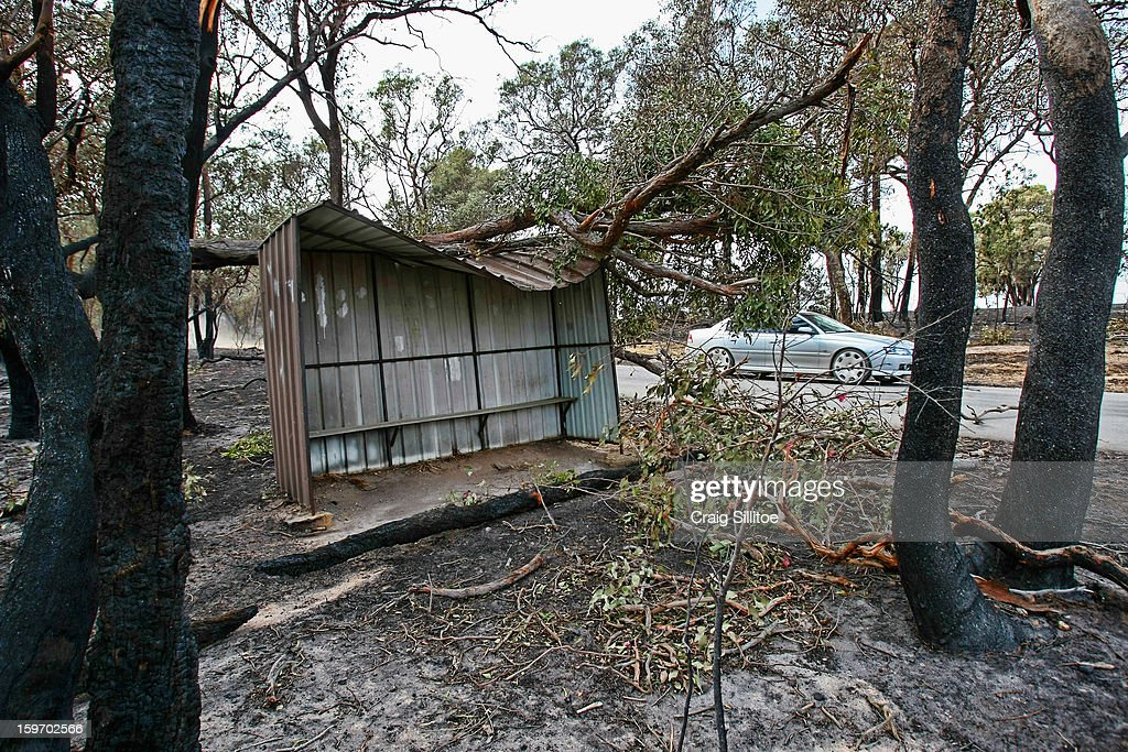 A bus shelter is damaged near the town of Seaton on January 19, 2013 in Melbourne, Australia. Bushfires in Victoria have claimed one life and destroyed several houses. Record heat continues to create extreme fire conditions throughout Australia.