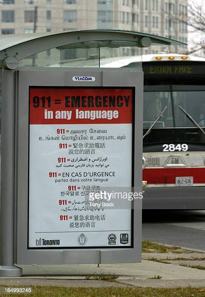 BUS SHELTER 11/17/04 Bus shelter on McCowan Avw north of Finch with poster showing some of the languages that the 911 service is available in