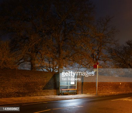 Bus stop at night in London. : Stock Photo