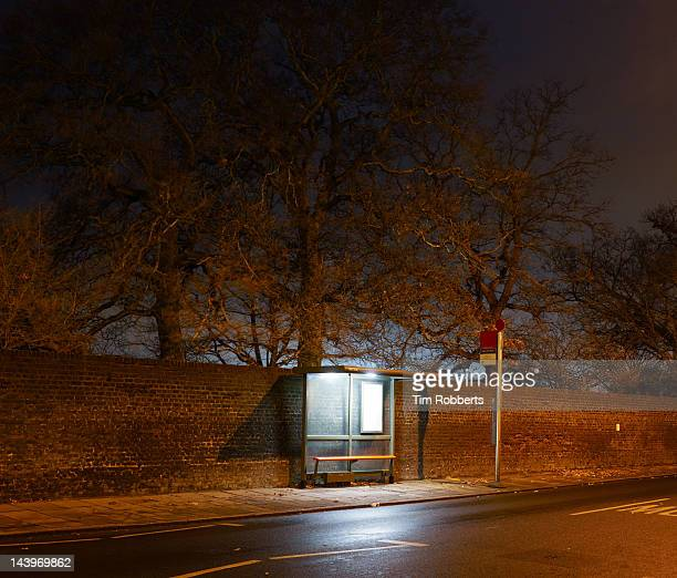 Bus stop at night in London.