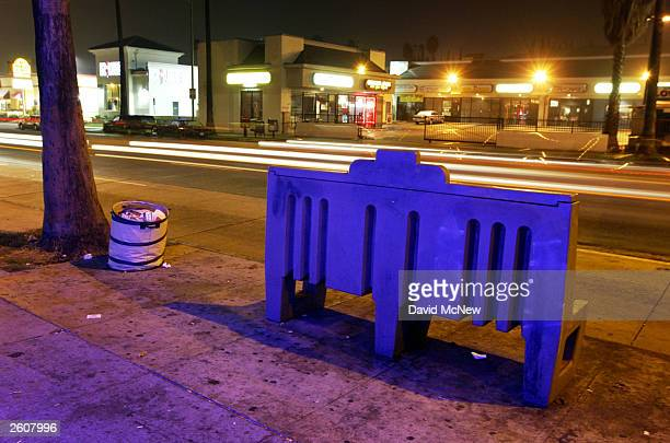 A bus stop bench illuminated by a heon sign goes unused as buses remain shutdown by the Metropolitan Transportation Authority mechanics strike on...