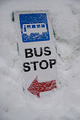But stop traffic sign with red arrow fall in snow