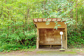 Bus stop in the forest. Japanese mountain road. Nostalgic scenery. Karuizawa in Nagano Prefecture.