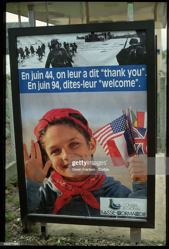 A bus stop poster in Normandy France welcomes returning veterans for the 50th anniversary of DDay and the Allies' landing sites of WW II A caption...