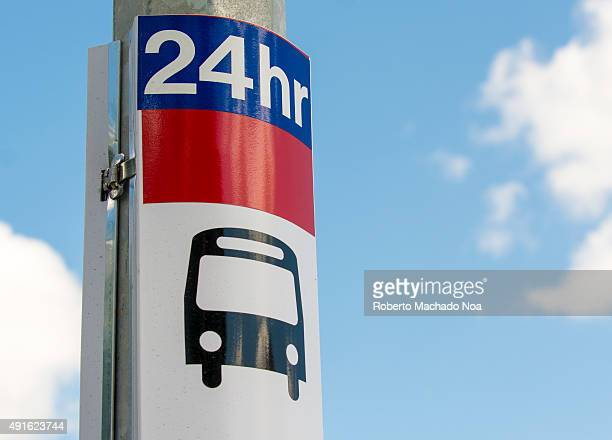 TTC bus stop where buses run 24 Hr a day A bus symbol over blue sky with white clouds 24 hours customer service sign icons
