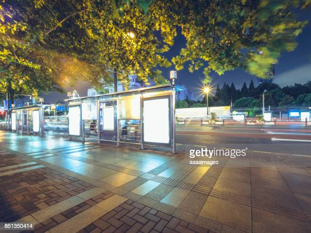 bus stop with illuminated blank billboard