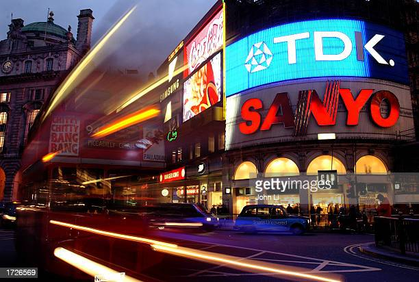 A bus travels across Piccadilly Circus January 14 2003 in London