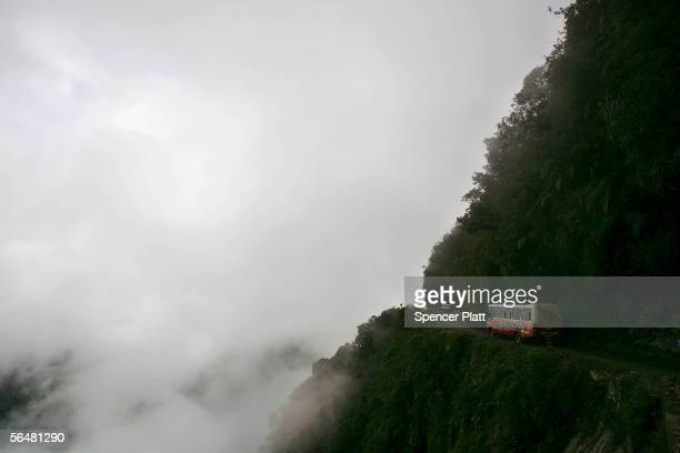 A bus travels the road connecting the city of La Paz to the Coroico in the North Yungas December 21 2005 in the Yungas Bolivia Referred to as the...