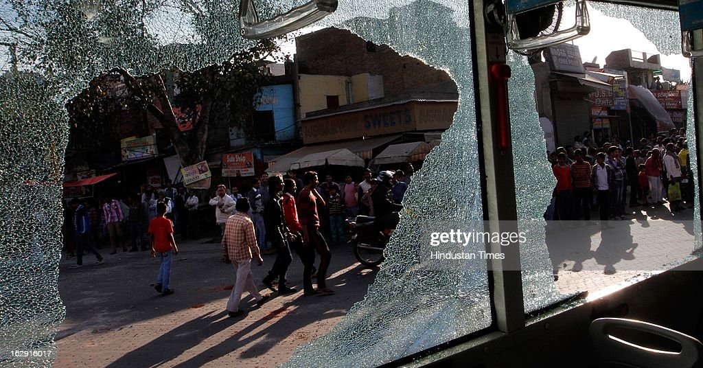 A DTC bus which has been ransacked by the mob near Sanjay Gandhi hospital during a protest after an eight-year-old girl, student of Class 2, was allegedly raped inside the premises of a North Delhi Municipal Corporation school at Mangolpuri Area on March 1, 2013 in New Delhi, India.