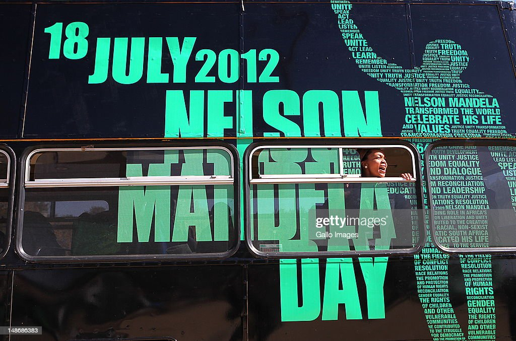 A bus with birthday wishes for Nelson Mandela is parked at Thokoza Park on Mandela's 94th birthday on July 18, 2012 in Soweto, South Africa. Children at the park were given cupcakes as part of the celebrations. Tributes from all over South Africa are celebrating Mandela's 94th Birthday on July 18.