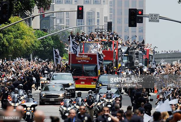 Bus with Los Angeles Kings team members and their families travels down Figueroa Street to the Staples Center during the Stanley Cup victory parade...