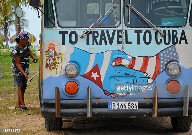 A bus with the Cuban and US flags is seen on a beach in Havana on August 12 2015 Cuba and the United States have restored full diplomatic relations...