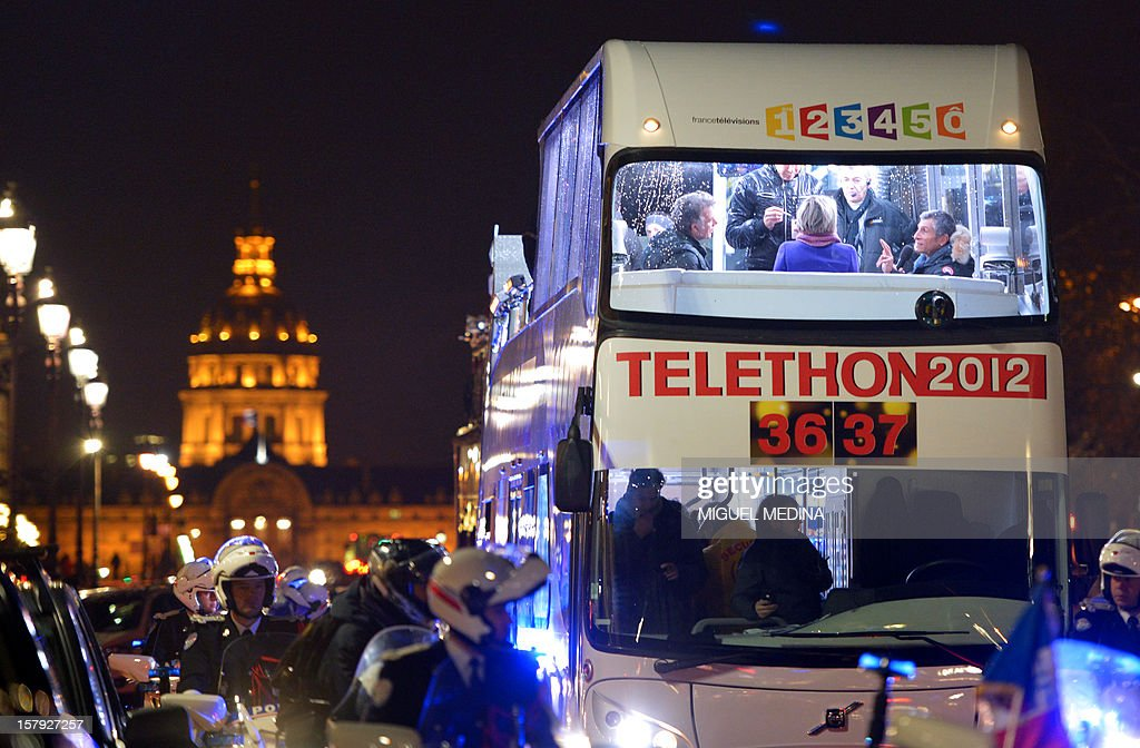 A bus, with TV hosts onbard, is escorted in Paris streets during a ceremony to launch the 26th Telethon, France's biggest annual fund-raising event on December 7, 2012. The event, aiming at collecting funds for research on genetic diseases such as myopathy, a neuromuscular disease, will take place on December 7 and 8, 2011. AFP PHOTO MIGUEL MEDINA