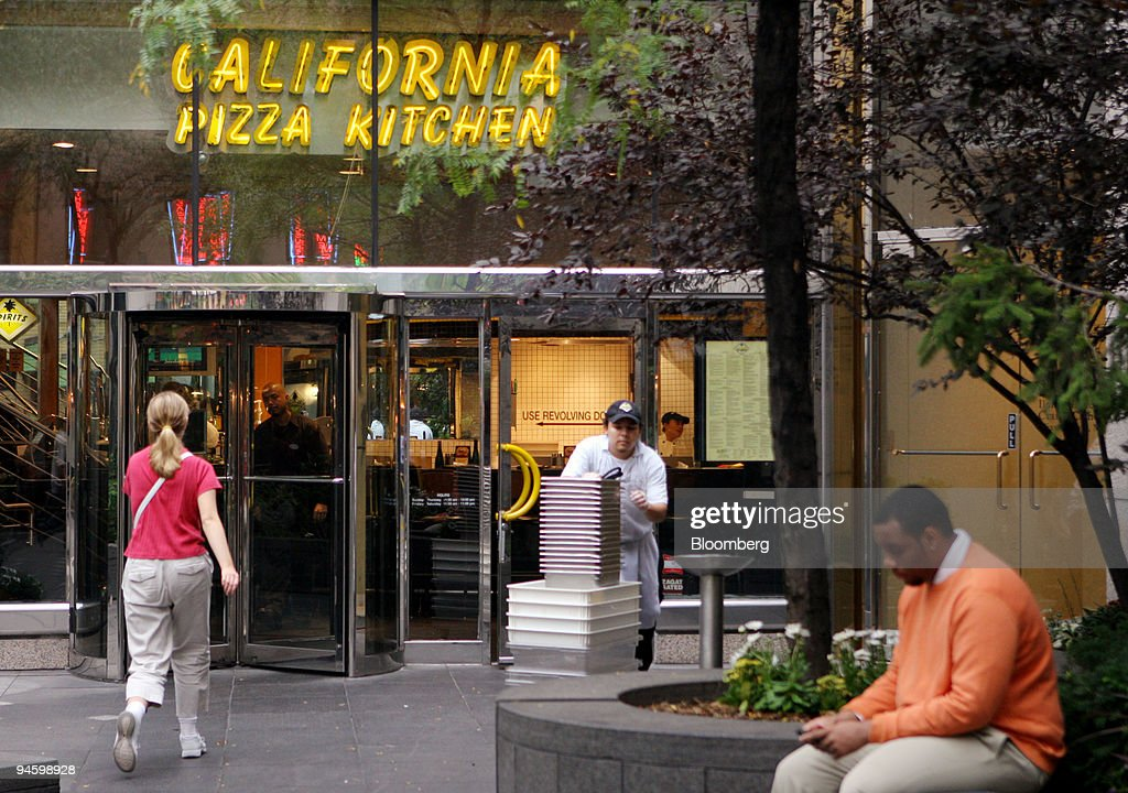 A busboy exits a California Pizza Kitchen Inc. restaurant in ...