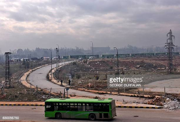 TOPSHOT Buses are seen during an evacuation operation of Syrian rebel fighters and civilians from a oppositionheld area of Aleppo towards rebelheld...