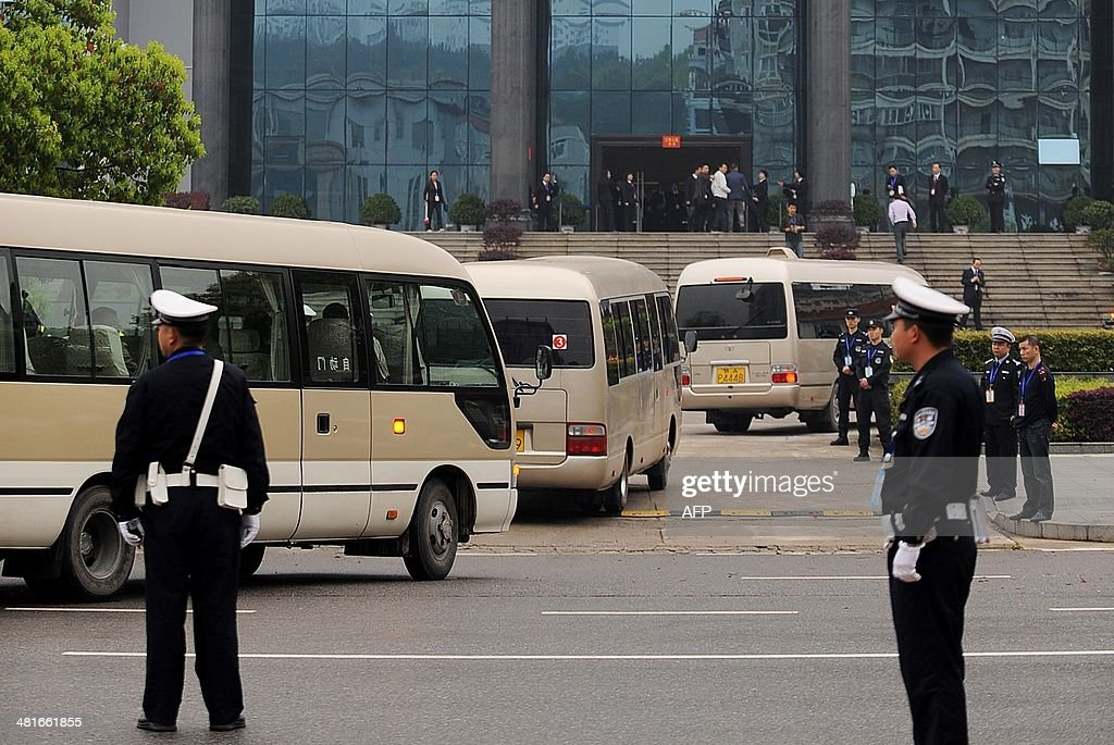 Buses arrive at the Xianning Intermediate People's Court where Chinese mining tycoon Liu Han stands trial in Xianning, central China's Hubei province on March 31, 2014. Liu Han, who once mounted a billion-dollar bid for an Australian company, went on trial for murder with 35 other alleged gang members, state media reported. The gang, based in Sichuan province in the southwest, are the biggest such 'mafia-style' group to face a courtroom in recent years, Xinhua said. CHINA