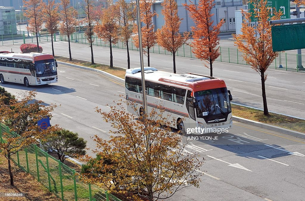 Buses carrying South Korean lawmakers leave for North Korea at the inter-Korean transit office in Paju near the Demilitarized zone dividing the two Koreas on October 30, 2013. A group of South Korean lawmakers crossed the border into North Korea to visit an inter-Korean factory complex in the communist country that has recently resumed operations after a five-month hiatus.