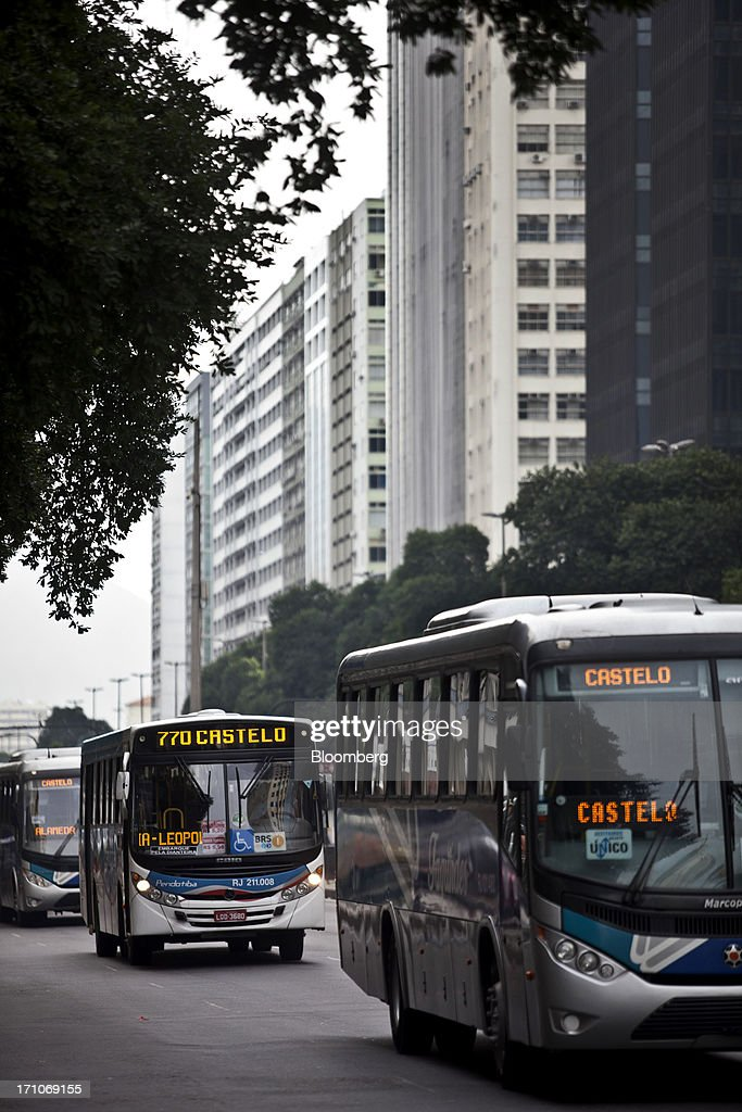 Buses drive down Presidente Getulio Vargas Avenue in Rio de Janeiro, Brazil, on Friday, June 21, 2013. Brazils swelling street rebellion claimed its second fatality in the largest and most violent protests yet, as 1 million demonstrators rallied for better public services and an end to corruption. Photographer: Dado Galdieri/Bloomberg via Getty Images