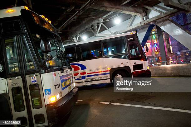Buses leave their stations at the Port Authority Bus Terminal during rush hour in New York US on Friday Dec 12 2014 The Port Authority of New York...
