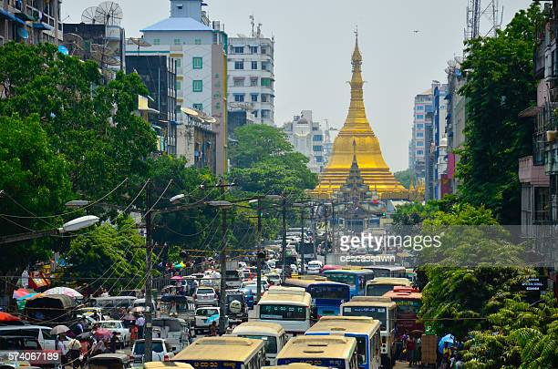 Buses moving on road in front of Sule Pagoda Again