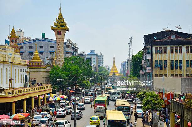 Buses moving on road in front of Sule Pagoda