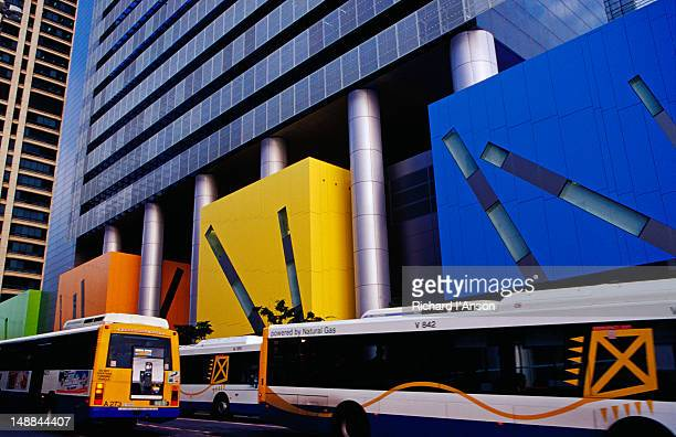 Buses on Adelaide Street passing Civic Library.