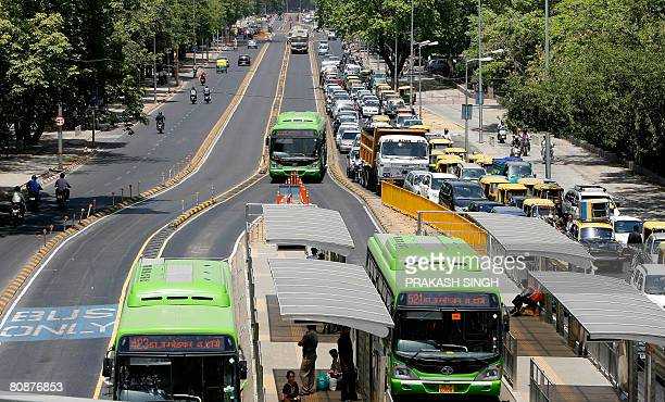 Buses ply on the road as commuters are stuck in a traffic jam at the Bus Rapid Transit corridor in New Delhi on April 27 2008 India's capital has put...