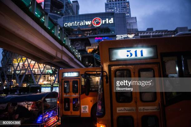 Buses sit in traffic outside the CentralWorld shopping mall at dusk in Bangkok Thailand on Wednesday June 21 2017 Stocks of consumer discretionary...