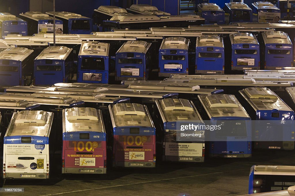 Buses stand idle at the Empresa Municipal de Transportes de Madrid (EMT) bus depot on the morning of a general strike in Madrid, Spain, on Wednesday, Nov. 14, 2012. Spanish unions today staged their second general strike against Prime Minister Mariano Rajoy as mounting opposition to budget cuts and bank bailouts undermines the 11-month-old government's ability to repair the economy. Photographer: Angel Navarrete/Bloomberg via Getty Images