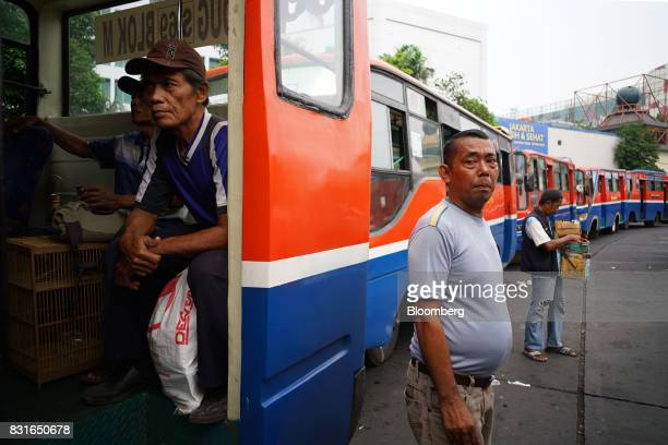Buses stand in a line at the Blok M bus terminal in Jakarta Indonesia on Sunday Aug 13 2017 President Joko Widodo is seeking hundreds of billions of...