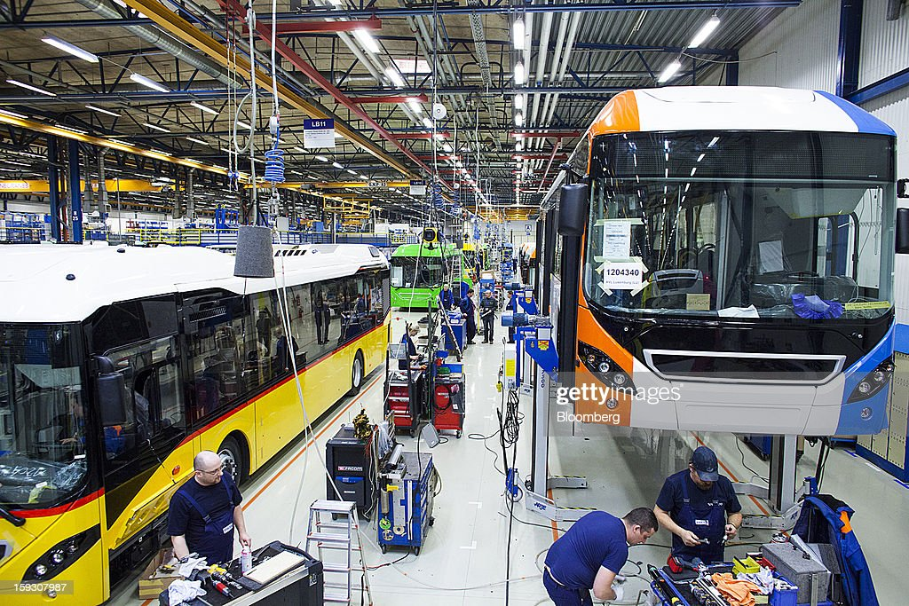 Buses stand on the production line during assembly at Volvo AB's bus manufacturing plant in Wroclaw, Poland, on Friday, Jan. 11, 2013. Volvo plans to end bus making in Saeffle by June 2013, and will consolidate the business in Europe to its main plant in Wroclaw, Poland, the Gothenburg, Sweden-based company said. Photographer: Bartek Sadowski/Bloomberg via Getty Images