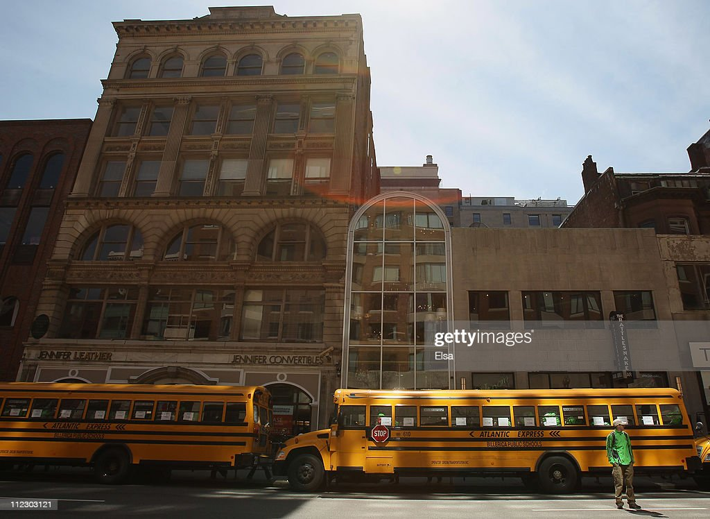 Buses wait at the end of the 115th Boston Marathon to transport runners on April 18, 2011 in Boston, Massachusetts.