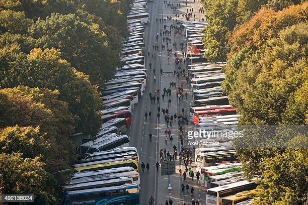 Buses wait for protesters gathering to demonstrate against the TTIP and CETA trade accords on October 10 2015 in Berlin Germany Tens of thousands...