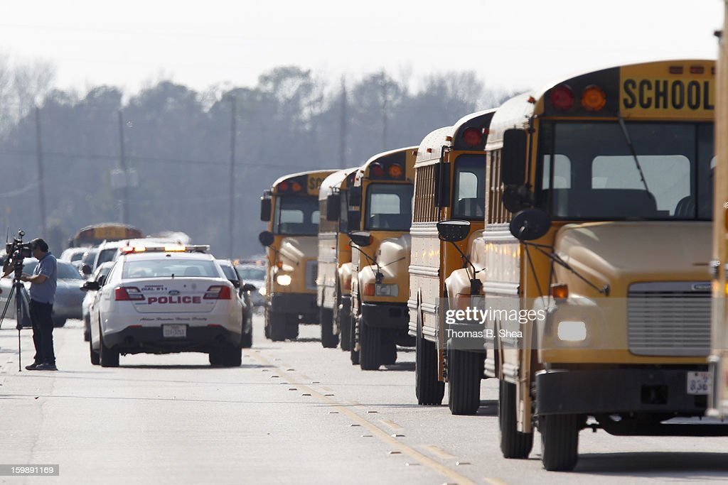 Buses wait to pick up children from area elementary schools after a shooting occurred at Lone Star College Campus on January 22, 2013 in The Woodlands, Texas. According to reports, three people were injured during a shooting on the courtyard between the Library and cafeteria.