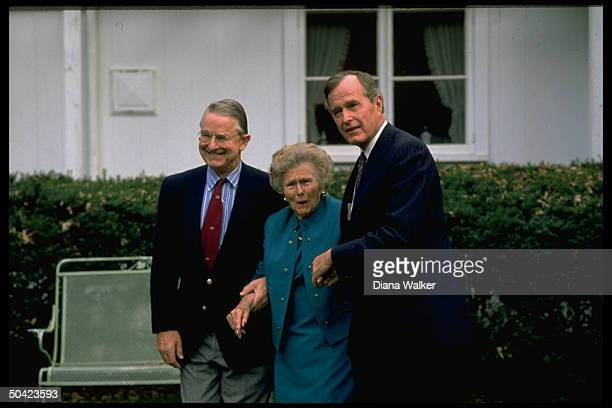 Bush family matriarch Dorothy Bush raising brows oohing for press w sons Pres George Prescott Jr flanking her w supportive grip