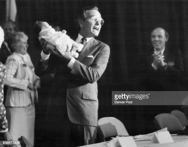Bush holds up his 6th Grandchild showing her to the Republican Deligate at the State Convention Her name is Lauren Pierce Bush she was born 2 weeks...