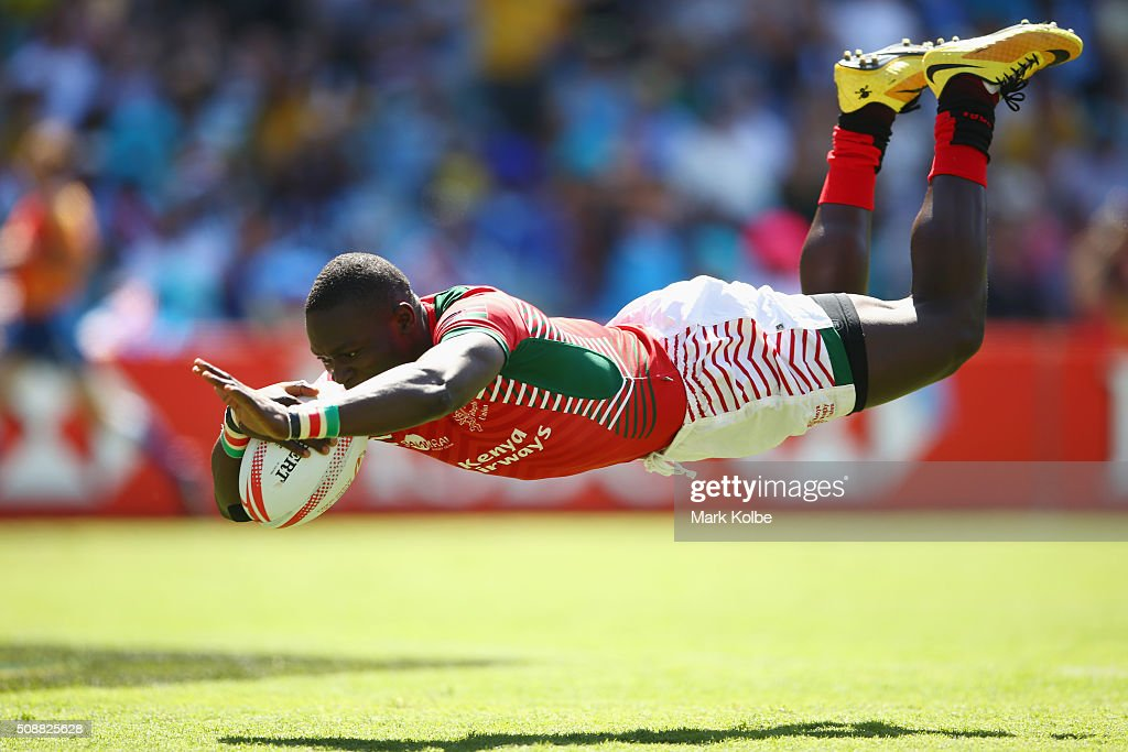 Bush Mwale of Kenya dives over to score a try during the 2016 Sydney Sevens playte semi final match between Kenya and the United States of America at Allianz Stadium on February 7, 2016 in Sydney, Australia.