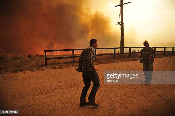 Bushfire rages out of control from the Bunyip State Park towards the townships of Labortouche and Tonimbuk Seen here farmers Tracey and Rod