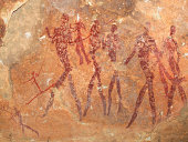Bushmen (san) rock painting depicting human figures, South Africa.