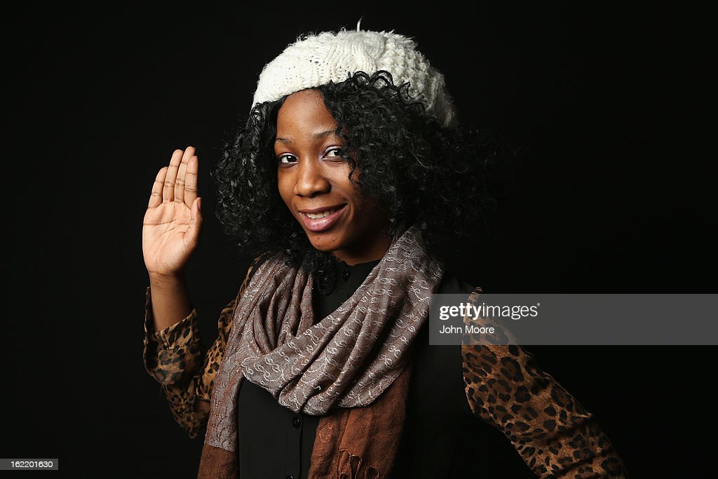 Bushra Salawu, 18, born in Nigeria, prepares to take the oath of allegiance to the United States at the U.S. Citizenship and Immigration Services (USCIS), office on February 19, 2013 in New York City. The 12th grade student at the Bronx Preparatory Charter School and daughter of a teacher said she moved from Nigeria to the Bronx, New York City, in 2000. Almost 300 foreign-born children of naturalized immigrants received citizenship certificates Tuesday at the USCIS center during the special event. Children of naturalized immigrants receive U.S. citizenship, if they arrive to the United States as minors, but they must go through a process at USCIS to receive official citizenship documents proving they have become Americans.