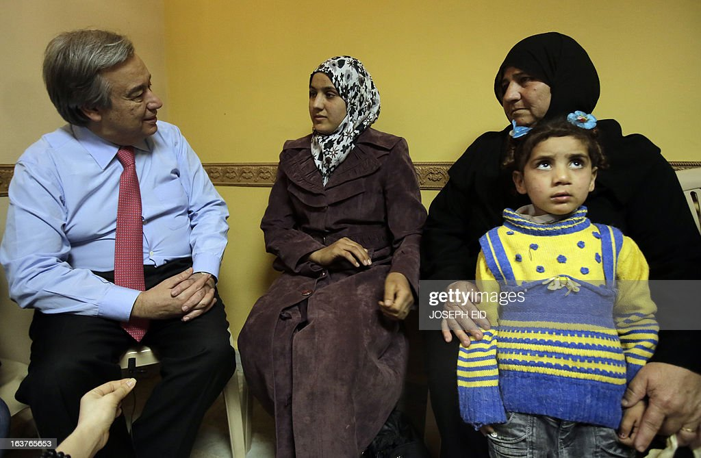 Bushra (C), who is the 1000000 registered Syrian refugee at the UNHCR meets with the UN High Commissioner for Refugee's Antonio Guterres (L) at a community center in the Al-Mina neighbourhood of the northern Lebanese city of Tripoli on March 15, 2013. Guterres said the number of Syrian refugees could double or triple by the end of the year if no solution is found to the conflict.
