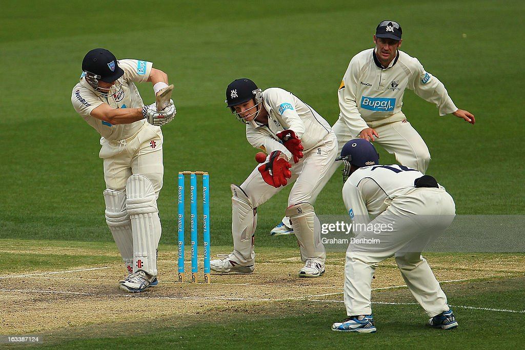 Bushrangers Wicketkeeper Peter Handscomb (C) catches out Peter Nevill of the Blues (L) from the bowling of Cameron White during day three of the Sheffield Shield match between the Victorian Bushrangers and the New South Wales Blues at Melbourne Cricket Ground on March 9, 2013 in Melbourne, Australia.