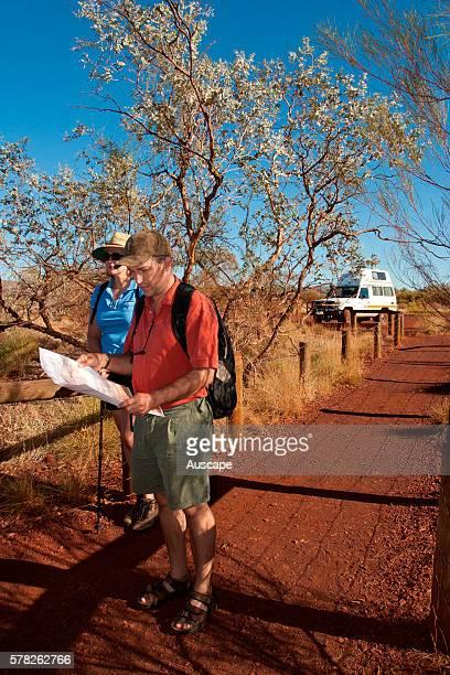 Bushwalkers consulting map Pilbara region Western Australia Australia