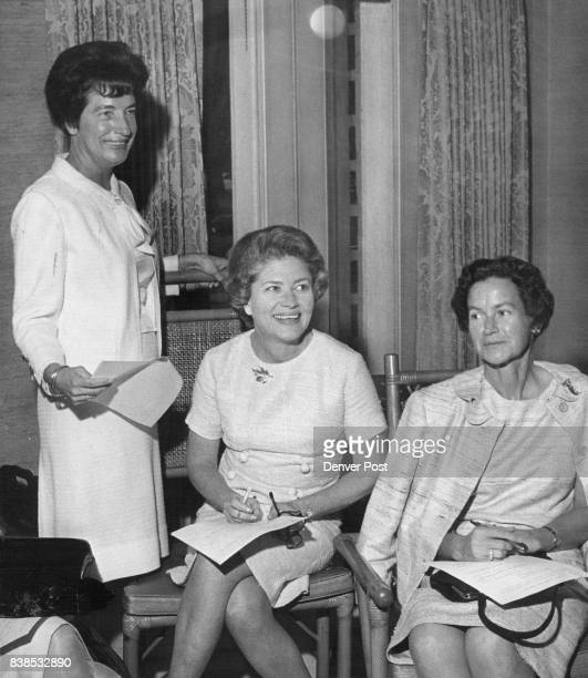 FOR ***** Busily checking lists for Debutante Ball are members of Patron Committee from left Mrs Richard W Mitchell Mrs Robert Gast and Mrs Clem...