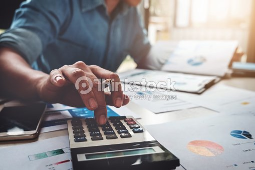 Business accounting concept, Business man using calculator with computer laptop, budget and loan paper in office. : Stock Photo