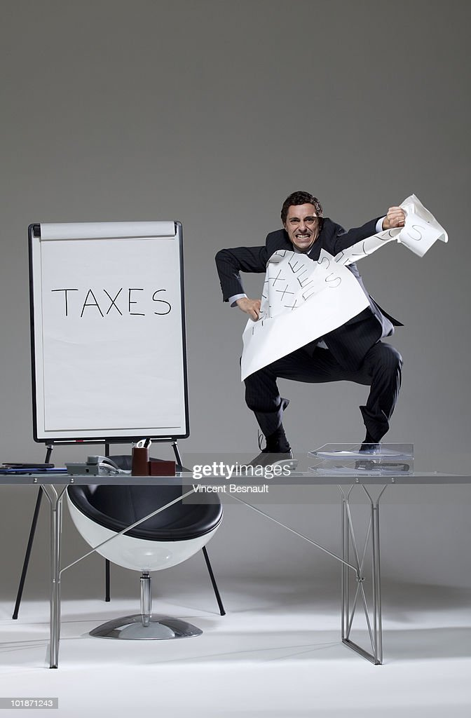 Business angrily tearing a sheet of paper : Stock Photo