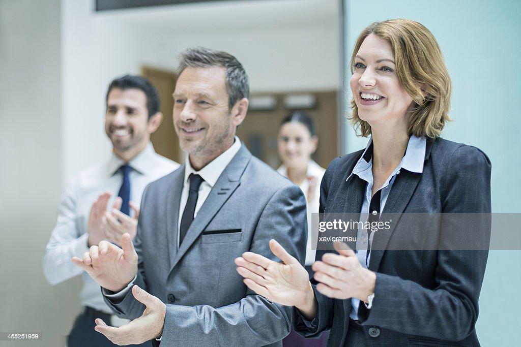 Business applauding success