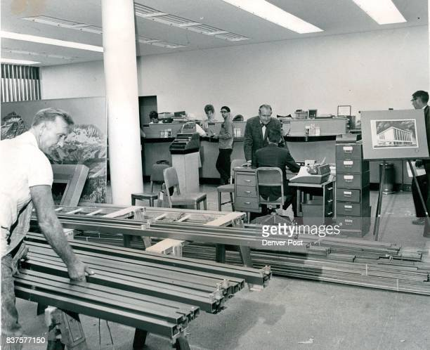 Business as Usual The clatter of complete remodeling sets a steady tempo at the Bank of Denver 1534 California St these daysbut the bank is carrying...
