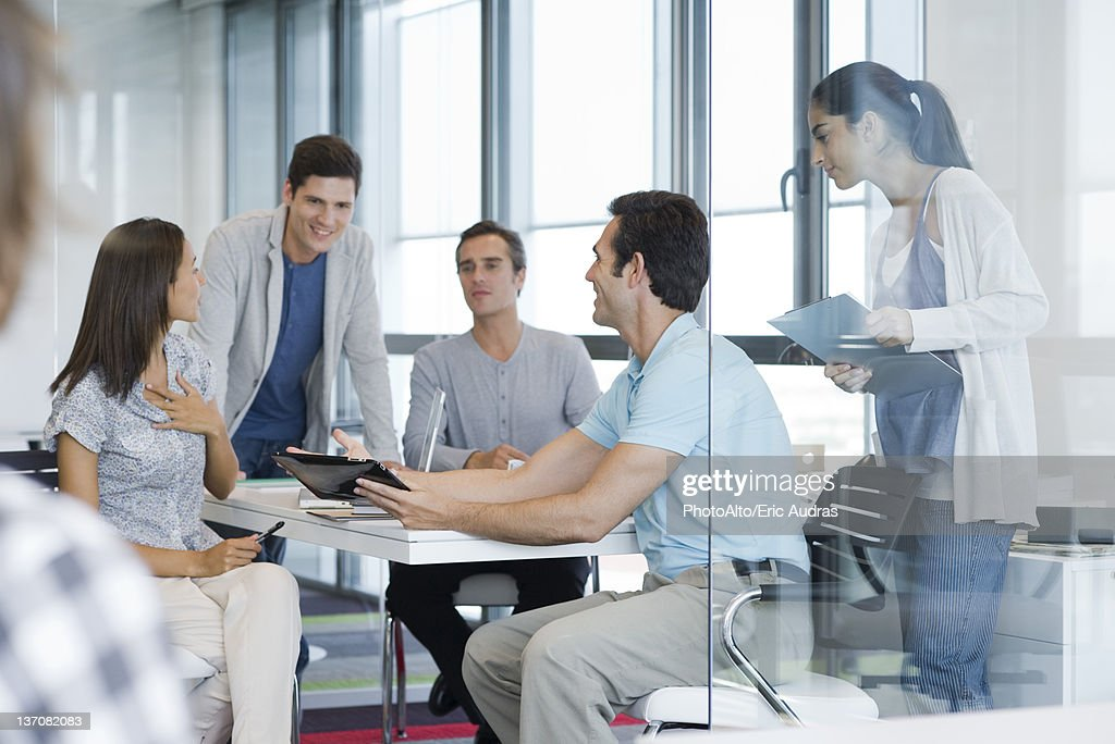 Business associates in casual meeting : Stock Photo